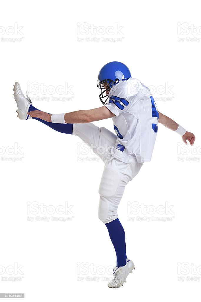 American football player in a kicking position stock photo