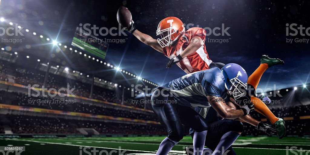 American football player in action on stadium stock photo