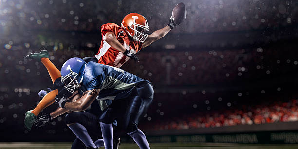 american football player in action on stadium - american football player stock photos and pictures