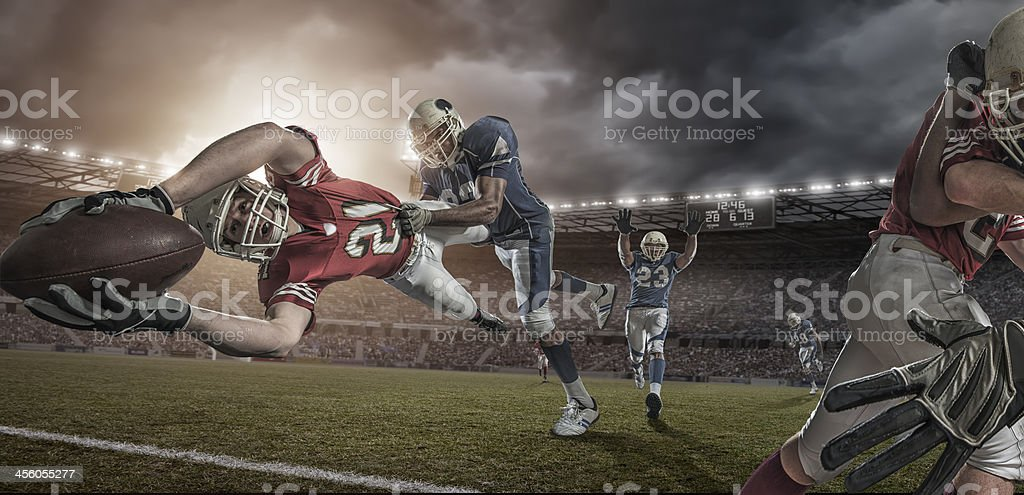 American Football Player in Mid Air Touchdown Tackle stock photo