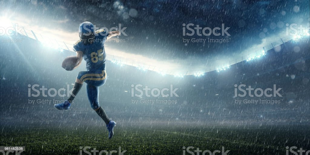 American football player in professional night sport stadium stock photo