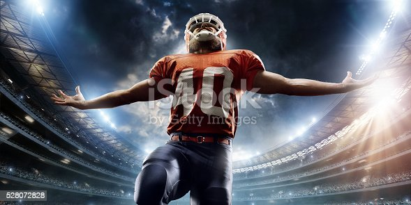 istock American football player is celebrating 528072828