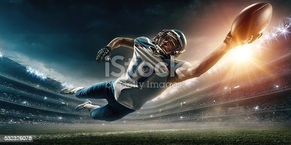 istock American football player jumping 532326078