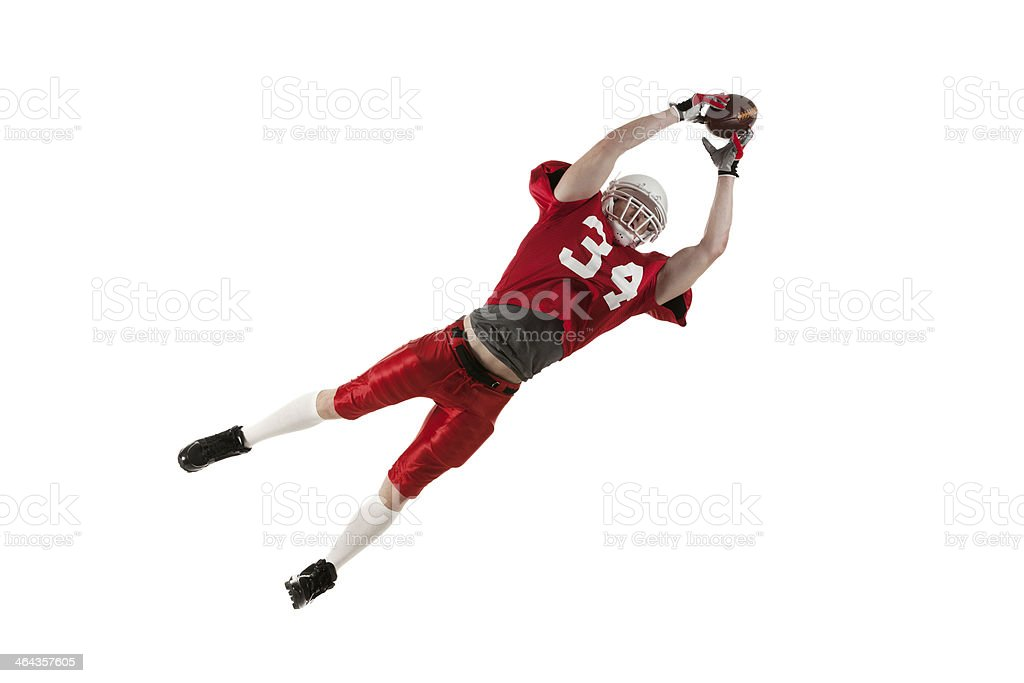 American football player jumping to catch the ball royalty-free stock photo