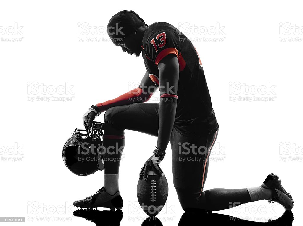 american football player kneeling silhouette stock photo