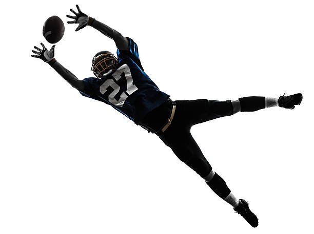 american football player man catching receiving silhouette one caucasian american football player man catching receiving in silhouette studio on white background wide receiver athlete stock pictures, royalty-free photos & images