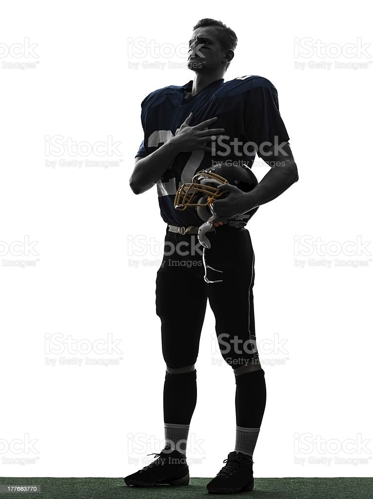 american football player man hand on heart silhouette stock photo