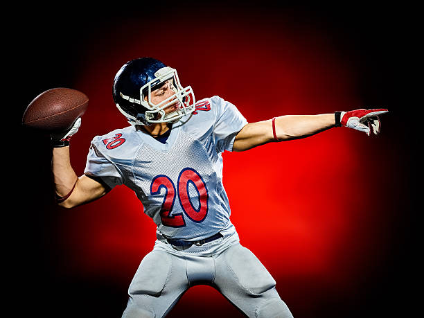 american football player man isolated one american football player man isolated on colorful black background quarterback stock pictures, royalty-free photos & images