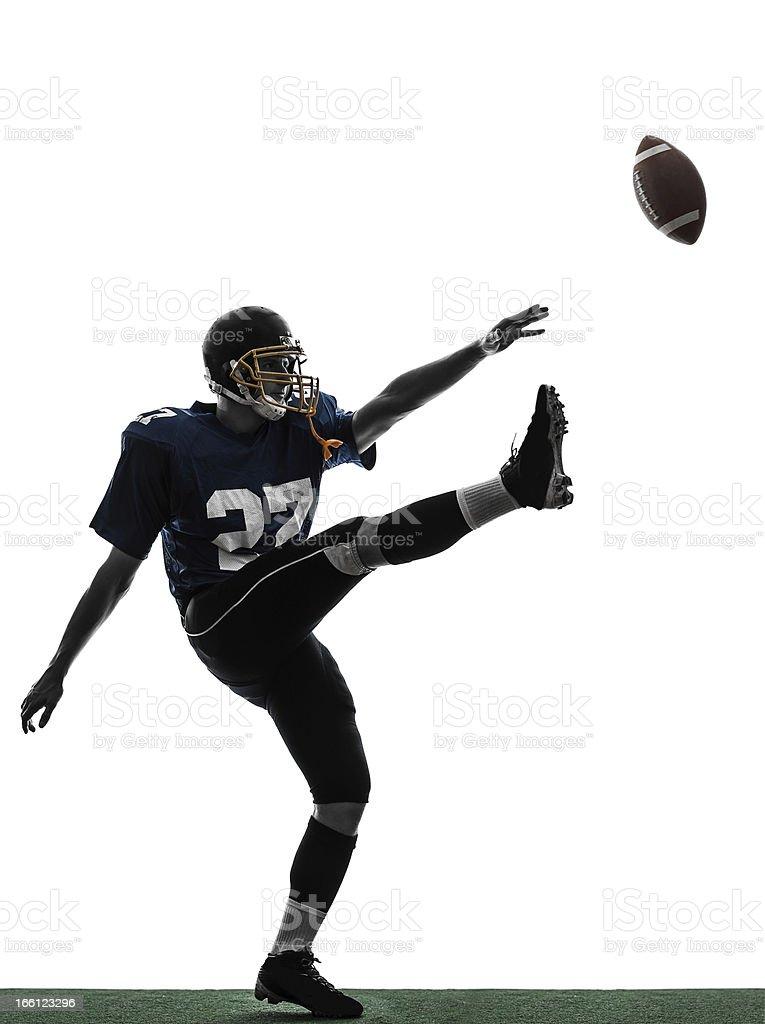 american football player man kicker kicking silhouette stock photo