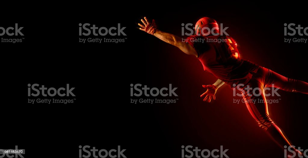 American football player on a dark red background stock photo