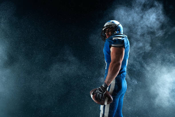 American football player on smoke background American football player american football player stock pictures, royalty-free photos & images