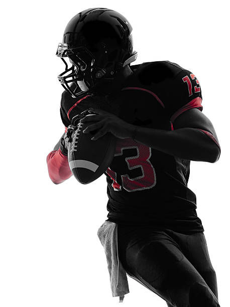 american football player quarterback portrait silhouette - american football player stock photos and pictures