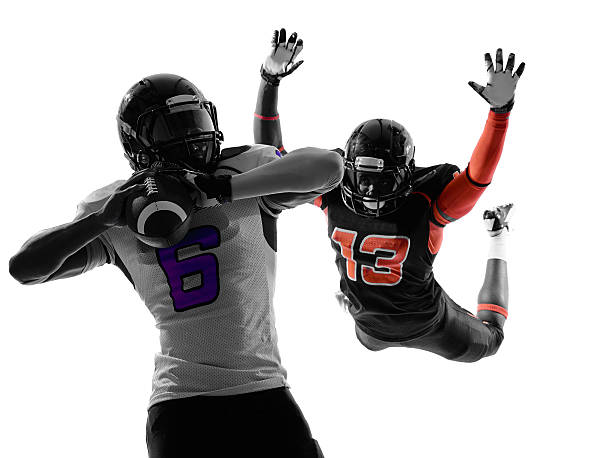 american football player quarterback sacked silhouette two american football players quarterback sacked in silhouette shadow on white background quarterback stock pictures, royalty-free photos & images
