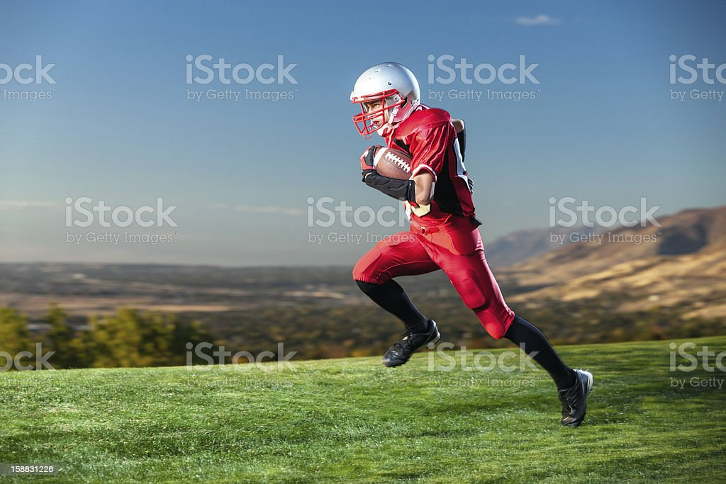 American Football Player Running the Ball stock photo