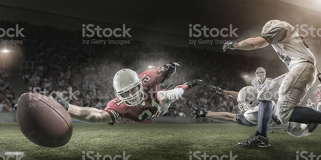 American Football Player Scores Touchdown stock photo