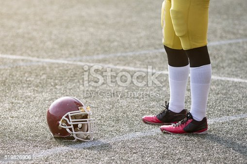 1176737230istockphoto American football player standing next to the sports helmet 519826906