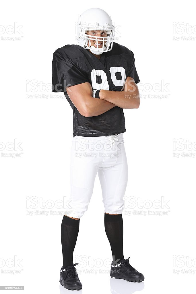 American football player standing with arms crossed stock photo