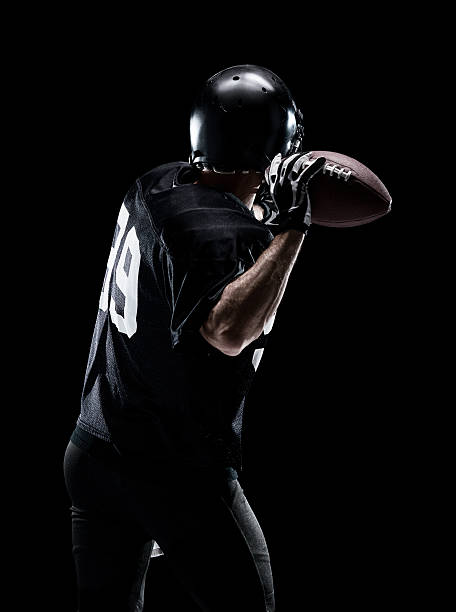 American football player throwing ball American football player throwing ball quarterback stock pictures, royalty-free photos & images