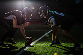 istock American football players are ready to start a match on modern field at night 1273594511