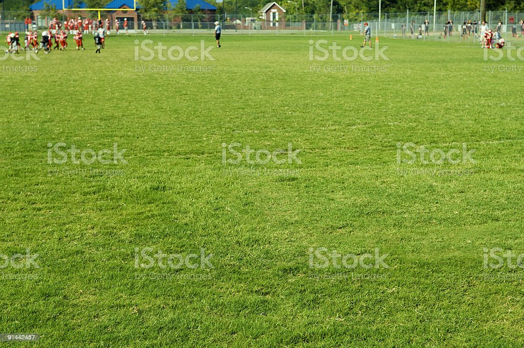 American Football Players at Football Game on Football Field stock photo