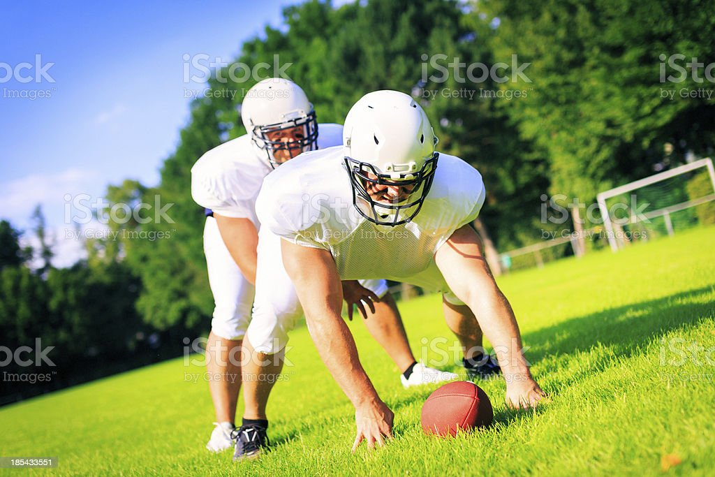 american football players at line of scrimmage royalty-free stock photo