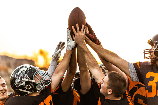 istock American Football Players Celebrating The Victory 1085339470