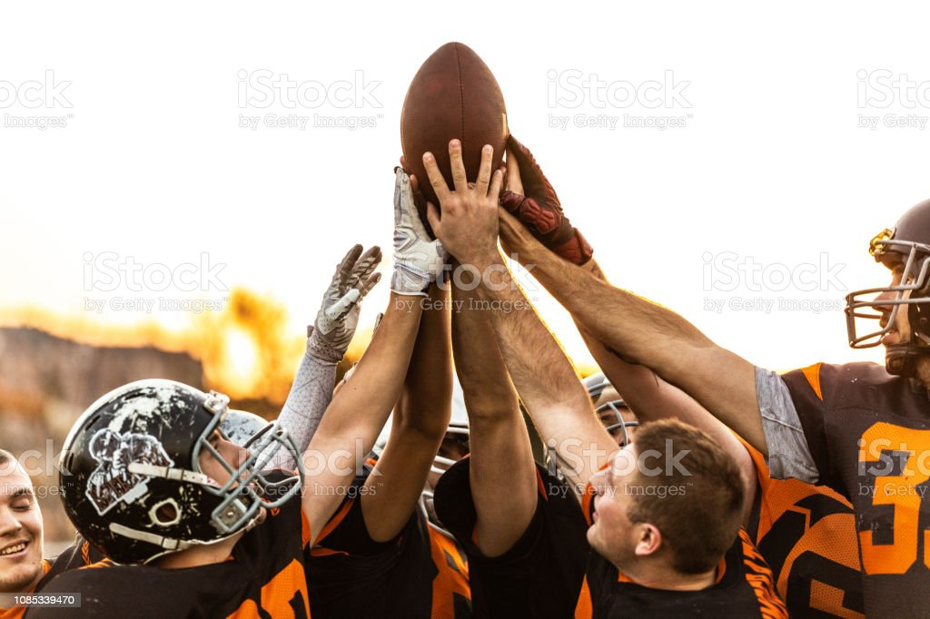 American Football Players Celebrating The Victory stock photo