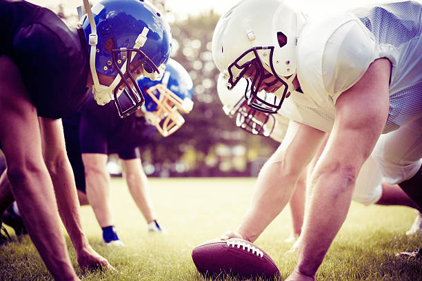 american football players facing each other american football players facing each other line of scrimmage stock pictures, royalty-free photos & images