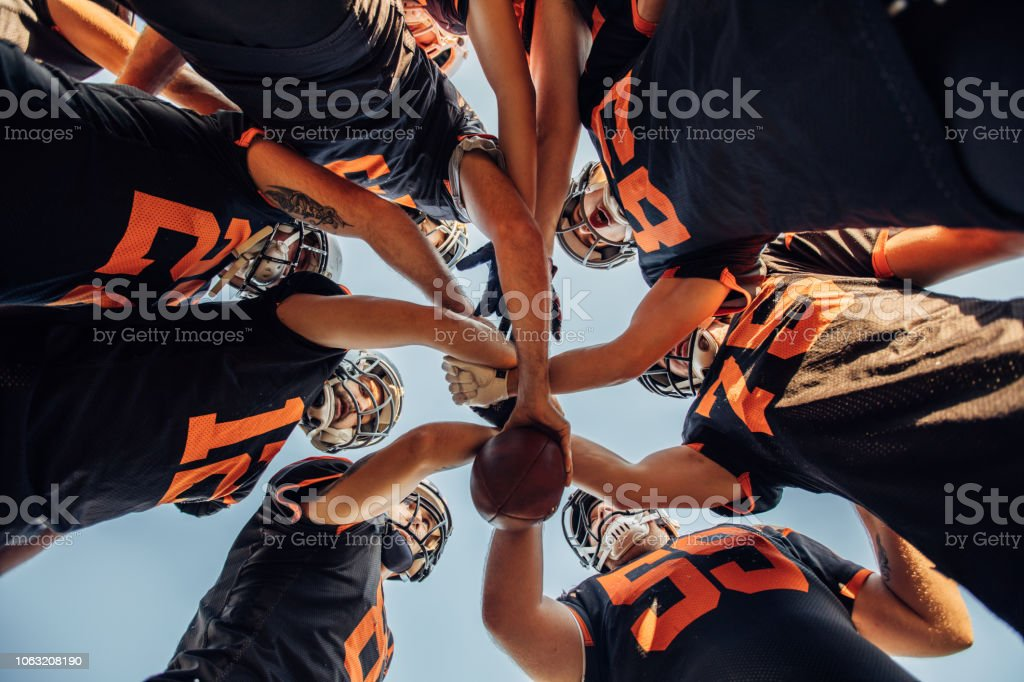 American Football Players Huddling During Time Out stock photo