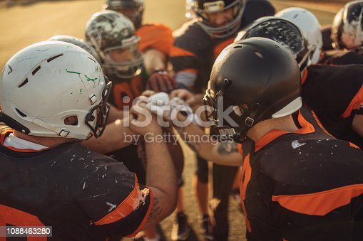 American Football Players Huddling During Time Out