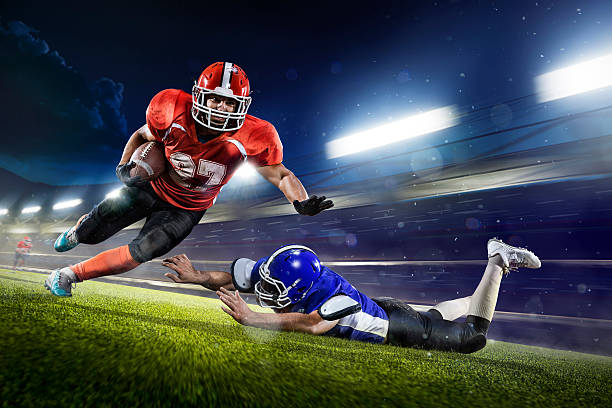 american football players in action on grand arena - american football player stock photos and pictures