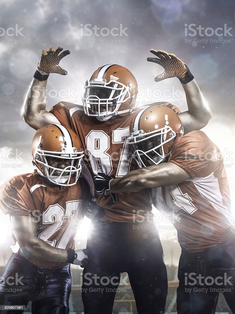 American football players in action on stadium stock photo