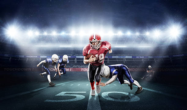 american football players in action on stadium with ball - american football player stock photos and pictures