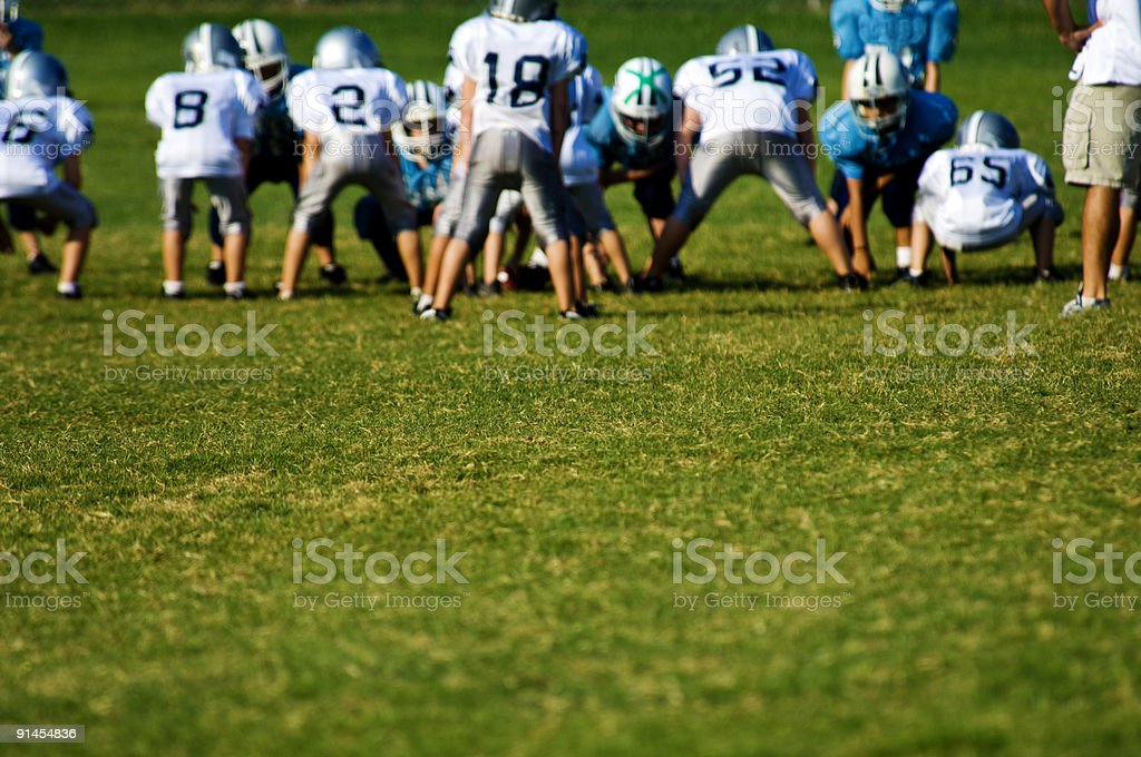 American Football Players on Football Field at Football Game stock photo