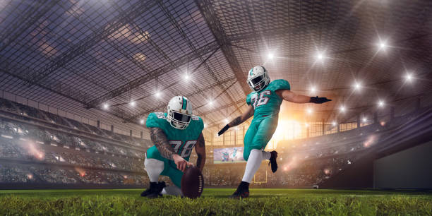 American football players. American football players on professional stadium on sunset. quarterback stock pictures, royalty-free photos & images