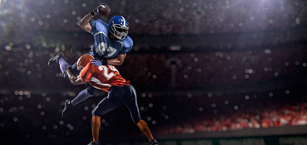 American football players American football players are playing on the big arena quarterback stock pictures, royalty-free photos & images