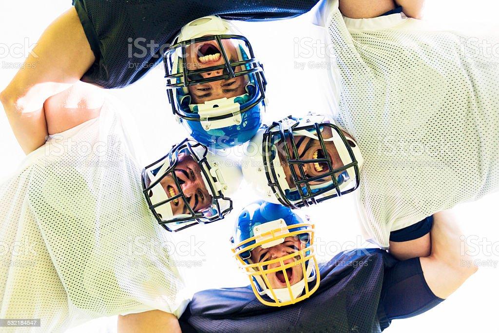 american football players posing stock photo