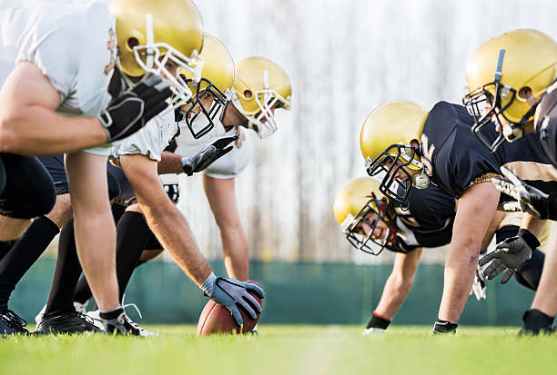 American football players positioning. American football players lining up. football lineman stock pictures, royalty-free photos & images