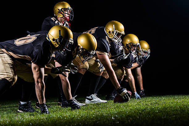 American football players positioning. American football players starting a match.    football lineman stock pictures, royalty-free photos & images