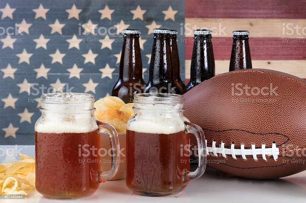 American football plus beer and chips with USA flag stock photo