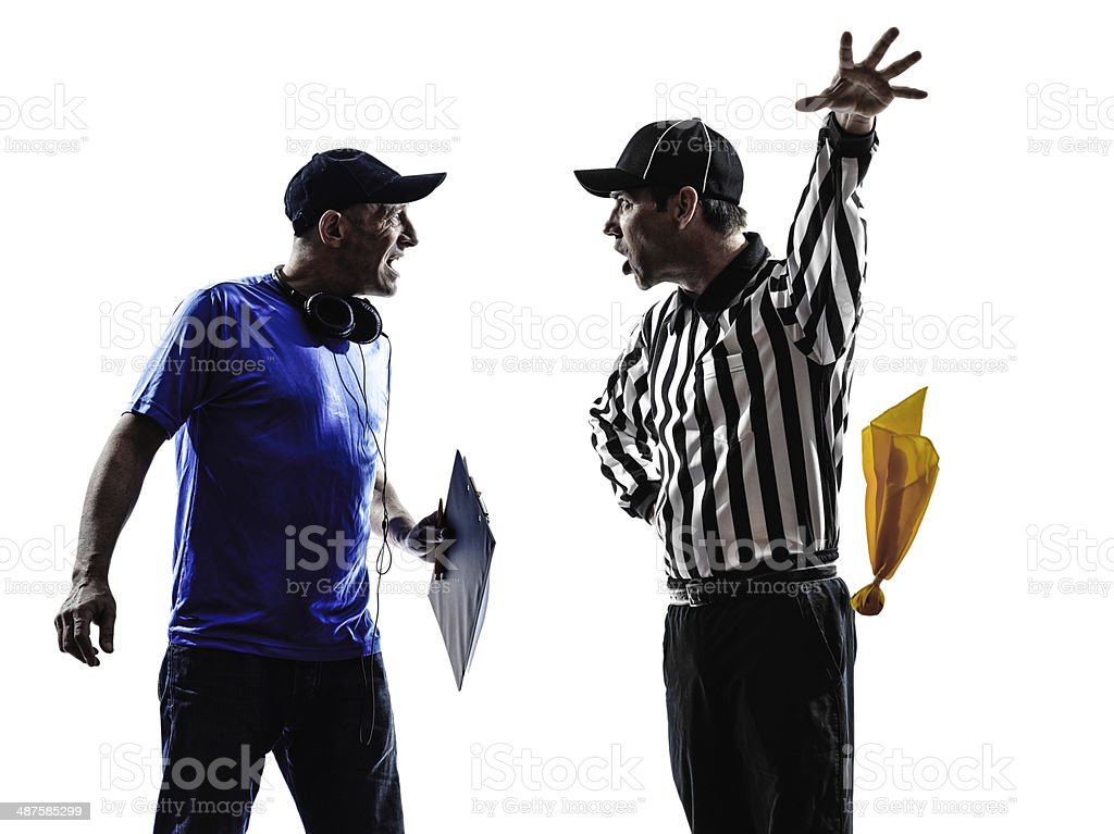 american football referee and coach conflict dispute stock photo
