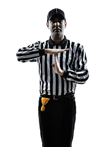 american football referee gestures time out silhouette american football referee gestures time out in silhouette on white background referee stock pictures, royalty-free photos & images