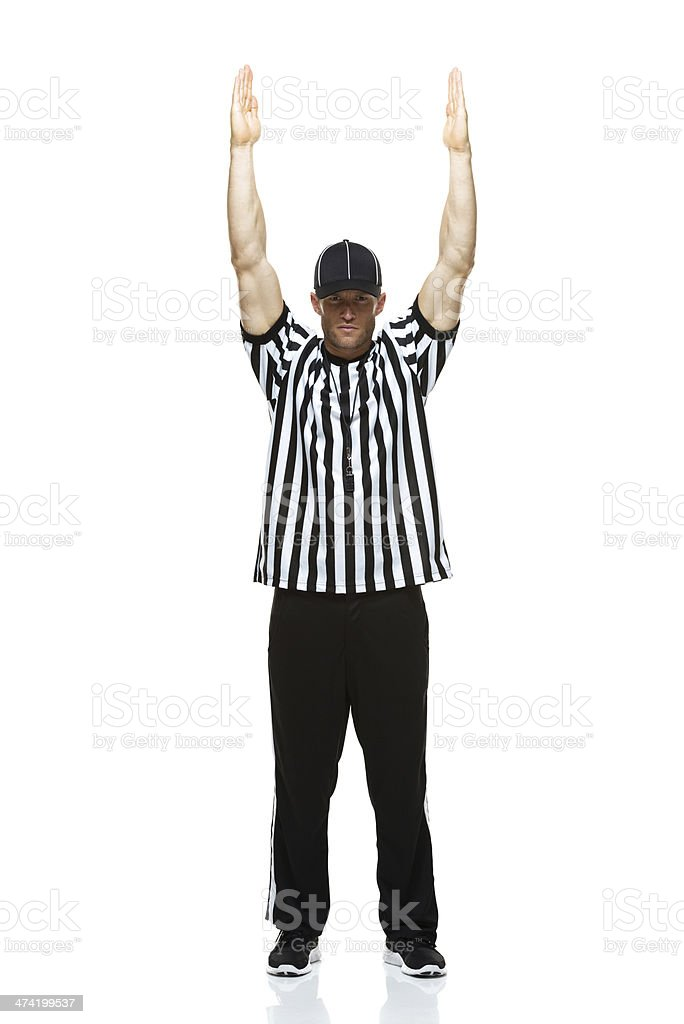 American football referee in action with touch down stock photo