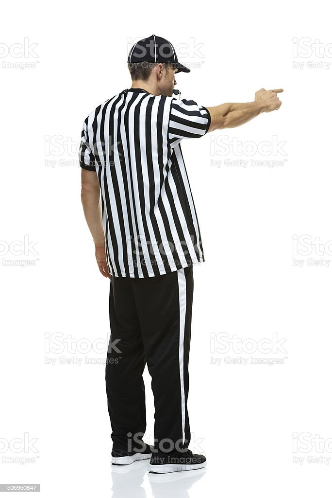 American football referee pointing and whistling royalty-free stock photo