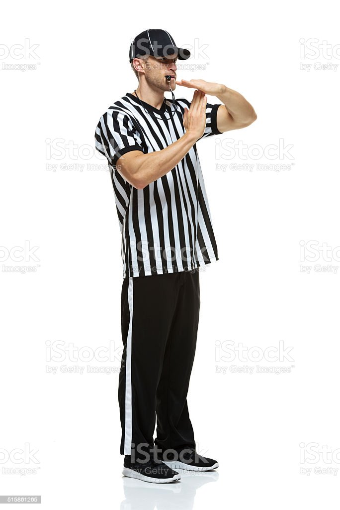 American football referee showing time out stock photo