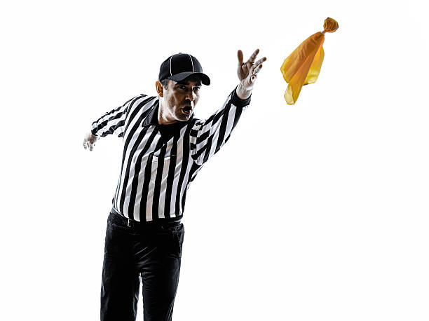 american football referee throwing yellow flag silhouette american football referee gestures in silhouette on white background referee stock pictures, royalty-free photos & images