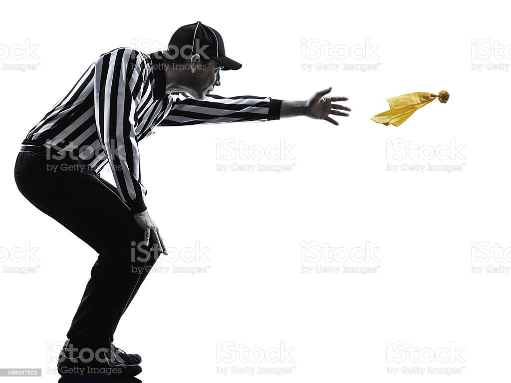 american football referee throwing yellow flag silhouettes stock photo