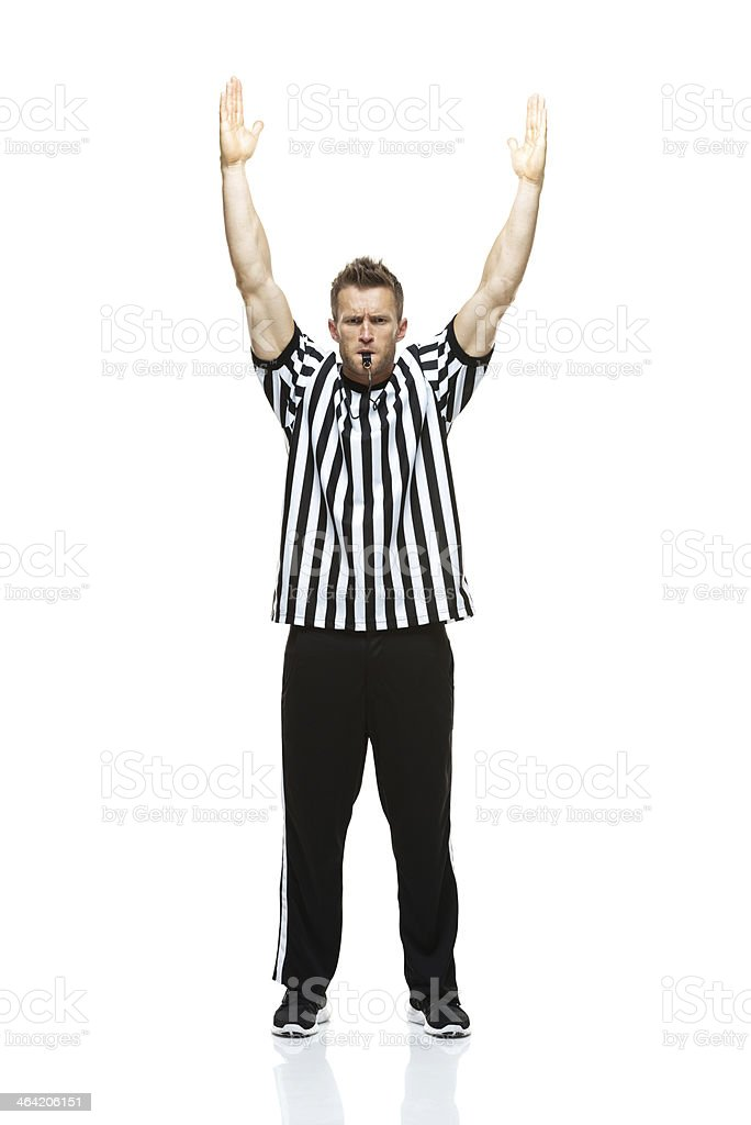 American football referee whistling with touch down stock photo