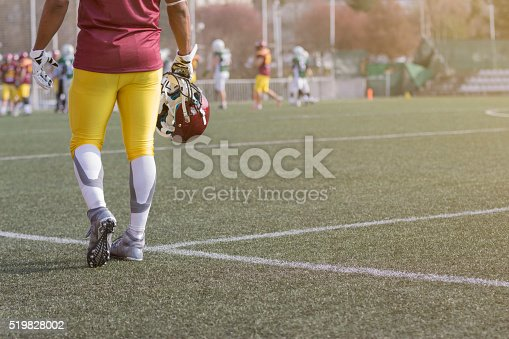 istock American football sportsman player holding helmet 519828002