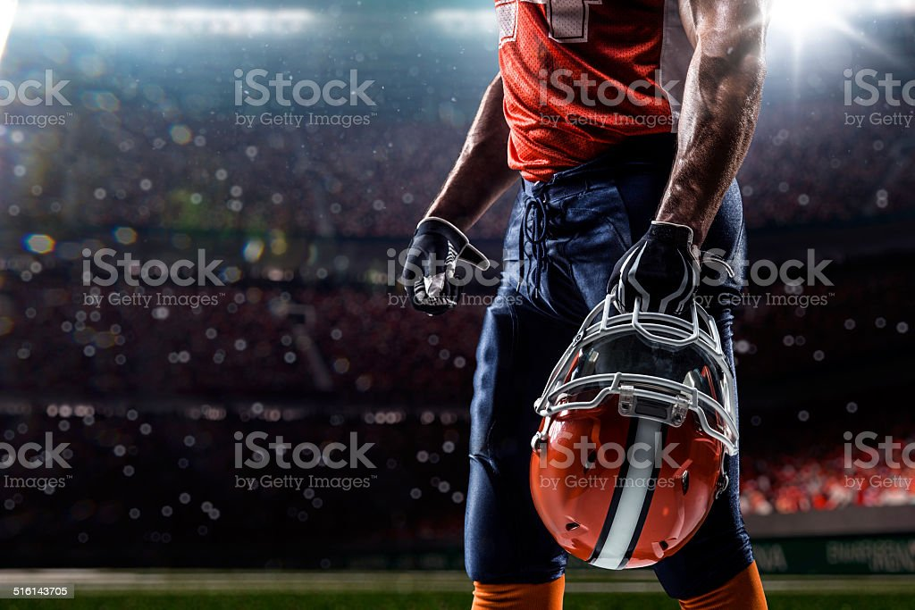 american football sportsman player in stadium stock photo